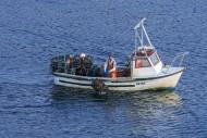 Fisherman in small fishing bo...