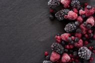 Frozen summer berries on a sl...