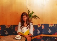 Young woman reading in a cafe