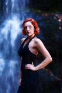 Elegant red-haired woman in f...