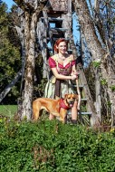 Woman in dirndl, with dog in ...
