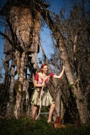 Woman in dirndl with raised a...
