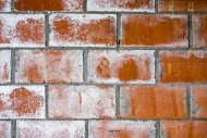 Red brick wall of newly built...