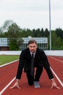 Man in a suit on a running tr...