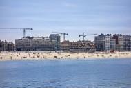 Tourists on the beach and fla...