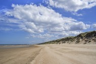 Sand dunes and sandy beach at...