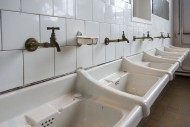 Row of dirty white sinks / wa...