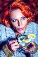 Red-haired woman with a glass...