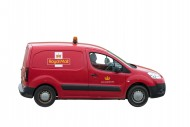 UK postman driving red Peugeo...
