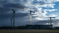 Construction cranes at a cons...