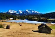 Alpine meadows with hay barn ...