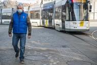 Tram and man wearing medical ...