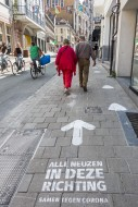 Arrow painted on pavement to ...