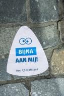 Sticker on pavement indicatin...