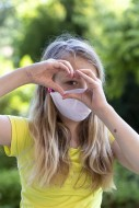 Girl (11) with mouth-nose pro...