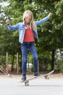 Girl (10) stands on tilting s...