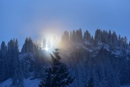 The sun breaks through the hi...