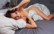 Naked woman lies on a bed