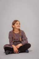 Girl sitting cross legged, is...