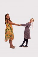 Two girls holding hands and d...