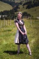 Blonde woman in a black desig...