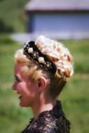 Blonde woman in lace dress wi...