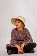 Girl sitting cross-legged, wi...