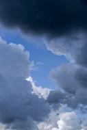 Gap in white and grey cumulus...