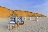 Roofed wicker beach chairs at...